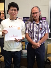 Jun Zhang receiving award from Malcolm Adams